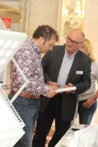 Exhibitor James Anthony Scotlens with Milo Murray at NIOS conference - NIOS